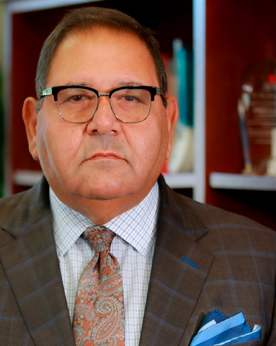 Akram Boutros, MD, President and CEO
