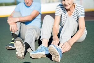 Seniors lacing up their sneakers to get ready to exercise