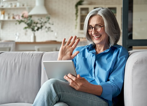 Woman using MyChart to visit with doctor