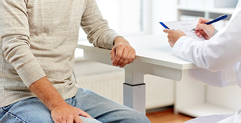 Patient sitting with doctor to discuss care