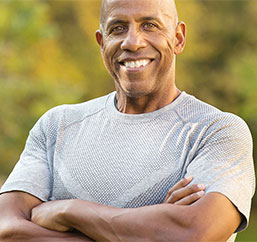 Man smiling after exercising as part of a weight loss program